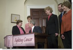 President George W. Bush shakes hands with Senator Barbara Mikulski (D-Md.), sponsor of H.R. 1132, the National Breast and Cervical Cancer Early Detection Program Reauthorization Act, after signing the bill Friday, April 20, 2007 in the Roosevelt Room of the White House. With them are, from right: Mrs. Laura Bush, Secretary Michael Leavitt of the Department of Health and Human Services, Wisconsin Congresswoman Tammy Baldwin, sponsor of the bill, and North Carolina Congresswoman Sue Myrick, co-sponsor of the bill.  White House photo by Shealah Craighead