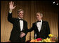 President George W. Bush joins White House Press Secretary Tony Snow at the head table for the White House Correspondents Association Dinner, Saturday evening, April 23, 2007 in Washington, D.C. White House photo by Shealah Craighead