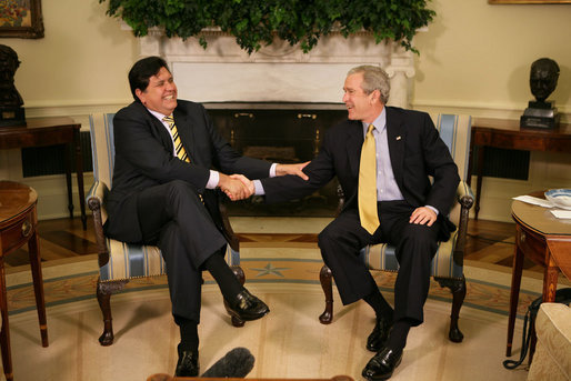 "President George W. Bush and President Alan Garcia of Peru share a light moment as they shake hands during a visit Monday, April 23, 2007, in the Oval Office. In the United States to promote free trade between the countries, the Peruvian leader said, ""It is important to show the world that a democracy, with investment, leads to development."" White House photo by Eric Draper"
