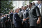 President George W. Bush greets members of the Indianapolis Colts football team at the White House ceremony to honor the Super Bowl XLI champions Monday, April 23, 2007. White House photo by Eric Draper