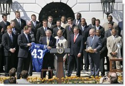 President George W. Bush is presented with a team jersey by Indianapolis Colts' quarterback Peyton Manning, left, and head coach Tony Dungy during a ceremony honoring their victory in the 2007 NFL Super Bowl Monday, April 23, 2007, on the South Lawn.  White House photo by Shealah Craighead