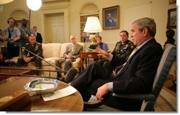 "President George W. Bush delivers a statement on the War in Iraq during a visit Monday, April 23, 2007, by Gen. David Petraeus, Commander of the Multinational Force-Iraq, to the White House. Said the President, ""I will strongly reject an artificial timetable withdrawal and/or Washington politicians trying to tell those who wear the uniform how to do their job."" With them is Gen. Peter Pace, Chairman of the Joint Chiefs of Staff, left, and Gordon England, Deputy Secretary of Defense.  White House photo by Eric Draper"