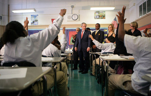Students in the seventh grade science class at Harlem Village Academy Charter School in New York, raise their hands to answer a question posed by President George W. Bush during his visit to the school Tuesday, April 24, 2007. White House photo by Eric Draper