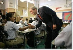 "President George W. Bush meets students in the seventh grade science class at Harlem Village Academy Charter School in New York, during his visit to the school Tuesday, April 24, 2007, where President Bush spoke about his ""No Child Left Behind"" reauthorization proposals.  White House photo by Eric Draper"
