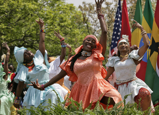 Members from the Kankouran West African Dance Company performs during a ceremony marking Malaria Awareness Day Wednesday, April 25, 2007, in the Rose Garden. White House photo by Eric Draper