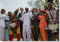 "President George W. Bush and Mrs. Laura Bush stands with the Kankouran West African Dance Company after delivering remarks during a ceremony marking Malaria Awareness Day Wednesday, April 25, 2007, in the Rose Garden. ""The American people, through their government, are working to end this epidemic,""said President Bush. ""In 2005, President Bush announced the President's Malaria Initiative -- a five-year, $1.2 billion program to combat malaria in the hardest-hit African nations.""  White House photo by Eric Draper"