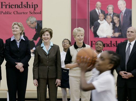 Mrs. Laura Bush, joined by Ambassador Karen Hughes left, and Linda Hargrove, general manager of the Washington Mystics, watches students playing basketball Wednesday, April 25, 2007, at the Friendship Public Charter School on the Woodridge Elementary and Middle School campus in Washington, D.C. Mrs. Bush visited the school to participate in Malaria Awareness Day events. White House photo by Shealah Craighead