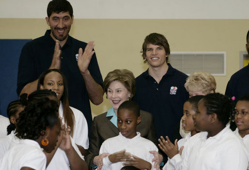 Mrs. Laura Bush, joined by NBA and WNBA players, prepares to pose for photos with fifth-grade students following a basketball game during a Malaria Awareness Day event Wednesday, April 25, 2007, at the Friendship Public Charter School on the Woodridge Elementary and Middle School campus in Washington, D.C. White House photo by Shealah Craighead