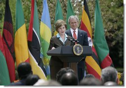 Mrs. Laura Bush is joined by President George W. Bush as she delivers remarks during a ceremony marking Malaria Awareness Day Wednesday, April 25, 2007, in the Rose Garden.  White House photo by Shealah Craighead