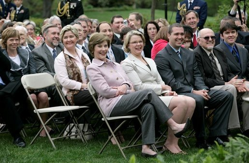 Mrs. Laura Bush and Secretary Margaret Spellings of the Department of Education, smile as they listen to remarks by President George W. Bush during Rose Garden ceremonies Thursday, April 26, 2007, honoring the 2007 Teachers of the Year. White House photo by Eric Draper