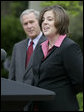 "President George W. Bush listens as Andrea Peterson, 2007 National Teacher of the Year, speaks during ceremonies Thursday, April 26, 2007, in the Rose Garden. Said the President, ""This is a special day for all who care deeply about education, because we fully understand that without a good teacher it's hard to achieve national goals and objectives."" White House photo by Eric Draper"