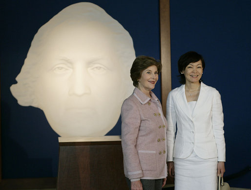 Mrs. Laura Bush and Mrs. Akie Abe, wife of Japanese Prime Minister Shinzo Abe, stand before a portrait of George Washington as they talk to members of the media, following a tour of the Mount Vernon Estate of George Washington Thursday, April 26, 2007, in Mount Vernon, Va. White House photo by Shealah Craighead