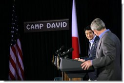 President George W. Bush and Prime Minister Shinzo Abe of Japan exchange nods as they open a joint press availability Friday, April 27, 2007, at Camp David. The meeting marked the first visit by Prime Minister Abe since coming to office.  White House photo by Eric Draper