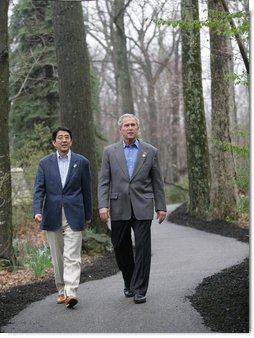 "President George W. Bush walks with Prime Minister Shinzo Abe during their meeting Friday, April 27, 2007, at Camp David. Said the President, "" We talked about the fact that our alliance -- and it is a global alliance -- is rooted in common values, especially our commitment to freedom and democracy."" White House photo by Eric Draper"
