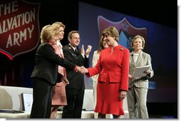 Mrs. Bush shakes hands with Marlene Klotz-Collins, National Advisory Board member, The Salvation Army, Friday, April 27, 2007, after delivering remarks during the Salvation Army's National Advisory Organization Conference in Dallas, Texas. Also shown, from left, are Sally Sharp Harris, Programs, National Advisory Board Members, Ralph Bukowitz, Major, Community Relation & Development Secretary, Charlotte Anderson, NAOC Chairman, National Advisory Board Member, and Ruth Altshuler, National Advisory Board Member. White House photo by Shealah Craighead