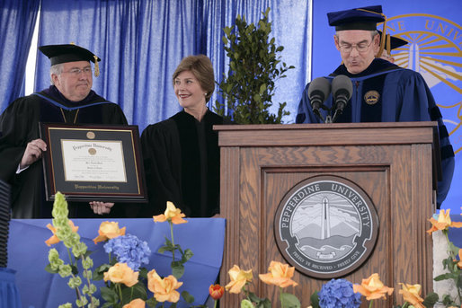 Mrs. Laura Bush receives an honorary Doctor of Laws degree from Dr. Andrew K. Benton, President of Pepperdine University Saturday, April 28, 2007, as Pepperdine Board of Regents member Eff W. Martin, delivers the Conferring Statement. The presentation came during the commencement ceremonies for the Class of 2007 at Pepperdine's Seaver College in Malibu. White House photo by Shealah Craighead