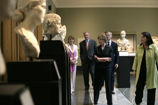 Mrs. Laura Bush walks through the Women of Antiquities exhibit Saturday, April 28, 2007, during a visit to the Getty Villa in Malibu, Calif. Mrs. Bush made the visit after delivering the commencement address to the 2007 graduates of Pepperdine University's Seaver College. She's joined by Dr. Karol Wight, right, Acting Curator of Antiquities at the J.Paul Getty Museum; Mrs. Louise Bryson, Chair of the J. Paul Getty Board of Trustees; Brad Freeman, second from left, longtime Bush family friend, and Dr. Michael Brand, Director of the J.Paul Getty Museum. White House photo by Shealah Craighead