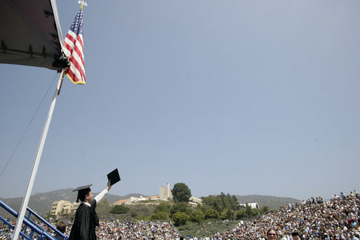 A graduate of the University of Pepperdine's Seaver College raises his diploma Saturday, April 28, 2007, during commencement ceremonies in Malibu, California. The event was highlighted by an address from Mrs. Laura Bush, who also received an honorary Doctor of Laws degree from the school. White House photo by Shealah Craighead