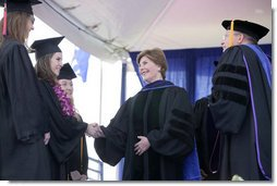 Mrs. Laura Bush congratulates the three Valedictorians of the 2007 graduating class at Pepperdine University's Seaver College Saturday, April 28, 2007, during commencement ceremonies on the Malibu, California campus. White House photo by Shealah Craighead