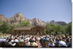 "Mrs. Laura Bush delivers remarks, Sunday, April 29, 2007, during the rededication ceremony of the Zion National Park Nature Center in Springdale, Utah. ""In Zion's peak season, the park welcomes 11,000 visitors a day,"" said Mrs. Bush. ""They come for the sport of canyoneering. They come to learn about this park's abundant plant life -- from the Utah Beavertail Cactus to the Bigtooth Maple to the Pigsweed Shrub.""  White House photo by Shealah Craighead"