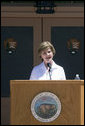 "Mrs. Laura Bush delivers remarks Sunday, April 29, 2007, during the rededication ceremony of the Zion National Park Nature Center in Springdale, Utah. ""Giving all Americans a sense of responsibility for our shared national heritage is vital to the health of our national parks,"" said Mrs. Bush. ""In 2009, Zion will celebrate a ""Century of Sanctuary,"" to commemorate when these lands were first set aside by President Taft in 1909."" White House photo by Shealah Craighead"