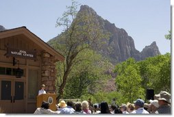 Mrs. Laura Bush delivers remarks, Sunday, April 29, 2007, during the rededication ceremony of the Zion National Park Nature Center in Springdale, Utah. Zion was Utah's first National Park, originally established as Mukuntuweap National Monument and change to Zion National Monument in 1919. High plateaus, a maze of narrow, deep sandstone canyons and striking rock towers and mesas characterize the park. White House photo by Shealah Craighead