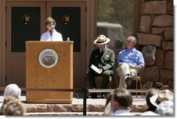 Mrs. Laura Bush speaks to a crowd of about 160 people Sunday, April 29, 2007, during the rededication ceremony of the Zion National Park Nature Center in Springdale, Utah. Interior Secretary Dirk Kempthorne is pictured at the far right. Designed by Gilbert Stanley Underwood in 1934, the center was renovated with new insulation, updated exterior side paneling and restrooms. White House photo by Shealah Craighead