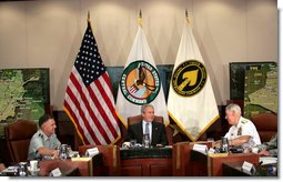 President George W. Bush joins Admiral William Fallon, right, Commander of the U.S. Central Command, and General Doug Brown, Commander U.S. Special Operations Command, during a visit Tuesday, May 1, 2007, to CENTCOM at MacDill Air Force Base in Tampa, Fla.  White House photo by Eric Draper