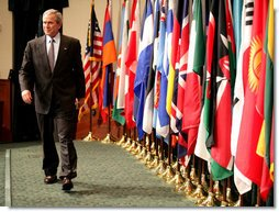 President George W. Bush walks on stage Tuesday, May 1, 2007, at Davis Conference Center at Tampa's MacDill Air Force Base, to deliver remarks to the CENTCOM Coalition Conference. White House photo by Eric Draper