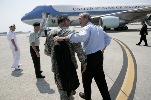 President George W. Bush walks with General David Petraeus, Commander of Multinational Force Iraq, as he prepares to board Air Force One Tuesday, May 1, 2007, after visiting CENTCOM at MacDill Air Force Base in Tampa, Fla. White House photo by Eric Draper