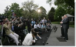 "President George W. Bush and President Alvaro Uribe of Colombia, deliver statements Wednesday, May 2, 2007, on the South Lawn of the White House. In introducing President Uribe to the media, President Bush said, ""It's been my honor to welcome a true democrat, a strong leader, and a friend.""  White House photo by Joyce N. Boghosian"