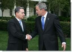 President George W. Bush and Colombia's President Alvaro Uribe exchange handshakes after delivering remarks Wednesday, May 2, 2007, on the South Lawn. President Uribe's visit underscores the friendship and extensive cooperation between the two countries. White House photo by Shealah Craighead