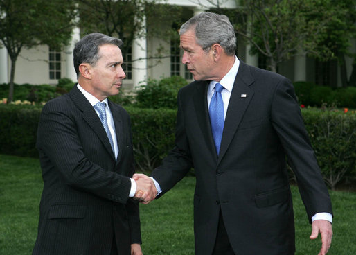 President George W. Bush and Colombia's President Alvaro Uribe exchange handshakes after delivering remarks Wednesday, May 2, 2007, on the South Lawn. President Uribe's visit underscores the friendship and extensive cooperation between the two countries. White House photo by Joyce Boghosian