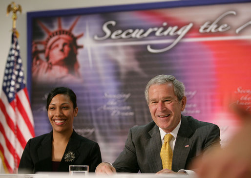 President George W. Bush is joined by Ana Karym, left, of Hyattsville, Md., a volunteer English as a Second Language teacher, during a meeting Thursday, May 3, 2007 on immigration and assimilation at the Asamblea de Iglesias Cristianas, Centro Evangelistico in Washington, D.C. White House photo by Eric Draper