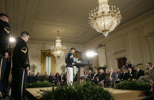 Cadet Chaplain Eun-Jae Yu, of the Virginia Tech Corps of Cadets, delivers the 2007 Prayer for the Nation to President George W. Bush and guests during an observance Thursday, May 3, 2007, of National Prayer Day in the East Room of the White House. White House photo by Eric Draper