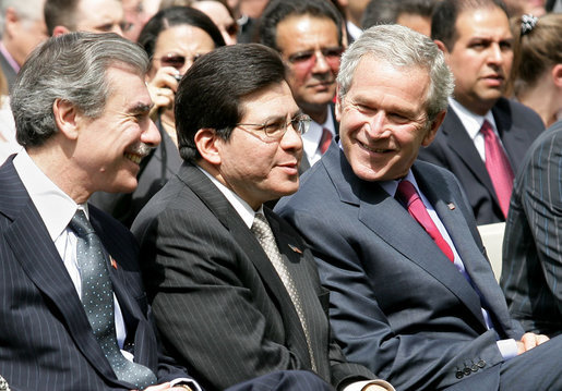 President George W. Bush is joined by U.S. Attorney General Alberto Gonzalez, center, and U.S. Secretary of Commerce Carlos Gutierrez in the Rose Garden at the White House Friday, May 4, 2007, during a celebration of Cinco de Mayo and to recognize the contributions of Mexican Americans. White House photo by Eric Draper