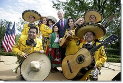President George W. Bush poses with members of the Los Hermanos Mora Arriaga mariachi band, who performed in the Rose Garden at the White House Friday, May 4, 2007, during a celebration of Cinco de Mayo. White House photo by Eric Draper
