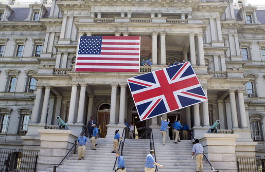 The Union Jack is raised next to the American flag Friday, May 4, 2007, at the Eisenhower Executive Office Building on the grounds of the White House in preparation for the visit Monday by Queen Elizabeth II and Prince Philip. White House photo by Lynden Steele