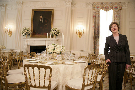 Mrs. Laura Bush describes the table setting arrangements for members of the media for the State Dinner at the White House Monday, May 7, 2007, hosted by President George W. Bush and Mrs. Bush in honor of Her Majesty Queen Elizabeth II and His Royal Highness The Prince Philip, Duke of Edinburgh. White House photo by Shealah Craighead