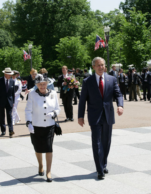 President George W. Bush escorts Her Majesty Queen Elizabeth II of Great Britain on a walk from the White House to Blair House Monday, May 7, 2007, where Queen Elizabeth II and His Royal Highness the Prince Philip, Duke of Edinburgh, are staying during their visit to Washington, D.C. White House photo by Eric Draper