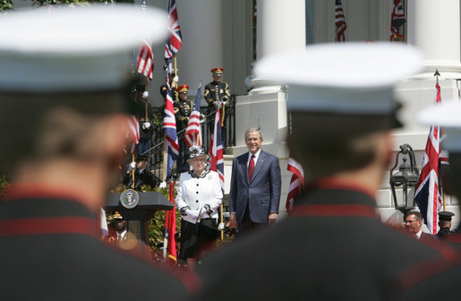 President George W. Bush and Her Majesty Queen Elizabeth II of Great Britain are framed between troops on review Monday, May 7, 2007, at the state arrival ceremony on the South Lawn of the White House. White House photo by Joyce Boghosian