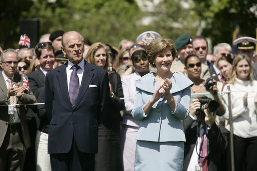 Mrs. Laura Bush is joined by His Royal Highness The Prince Philip, Duke of Edinburgh, at the state arrival ceremony for Her Majesty Queen Elizabeth II of Great Britain Monday, May 5, 2007, on the South Lawn of the White House. White House photo by Shealah Craighead