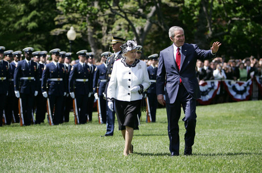 President George W. Bush waves to guests as he escorts Her Majesty Queen Elizabeth II of Great Britain during a review of the troops Monday, May 7, 2007, at the state arrival ceremony on the South Lawn of the White House. White House photo by David Bohrer
