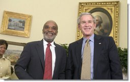President George W. Bush and President Rene Preval of Haiti stand in the Oval Office Tuesday, May 8, 2007, during a photo opportunity with the media. The leaders were expected to discuss a range of issues, including recent efforts by the United Nations stabilization mission in Haiti to enhance security and opportunities for promoting growth and prosperity in Haiti.  White House photo by Joyce Boghosian