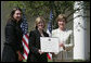 Mrs. Laura Bush presents a plaque to Abbe Raven, center, president and CEO of A&E Television Networks, and Nancy Dubuc, president of The History Channel, honoring them with a 2007 Preserve America Presidential Award in the Rose Garden at the White House Wednesday, May 9, 2007, honored for the establishment of the Save Our History grant program for historic preservation, and promotion of the historic hertiage of America. White House photo by Joyce Boghosian