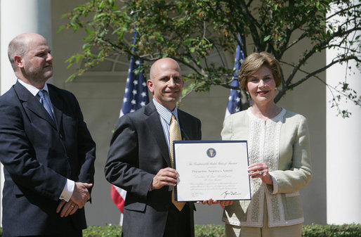 Mrs. Laura Bush presents a plaque to Craig Heller, center, president of Loftworks and John Steffen, left, president of Pyramid Construction, honoring them with a 2007 Preserve America Presidential Award in the Rose Garden at the White House Wednesday, May 9, 2007. The Steffen and Heller companies were honored for their work in preserving and revitalizing the historic downtown of St. Louis, Mo. White House photo by Joyce Boghosian