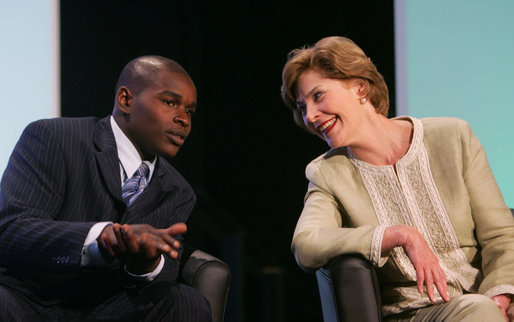 Mrs. Laura Bush talks with student Lyle Oates of the YouthBuild Alternative School in Cambridge, Mass., following her address Wednesday, May 9, 2007 in Washington, D.C., at the National Summit on America's Silent Epidemic highlighting America's high school dropout crisis. Mrs. Bush encouraged communities across the nation to come together and take action to reduce the high school dropout rate. Oates, who was out of school for two years, is now working toward his diploma and plans to attend college. White House photo by Joyce Boghosian
