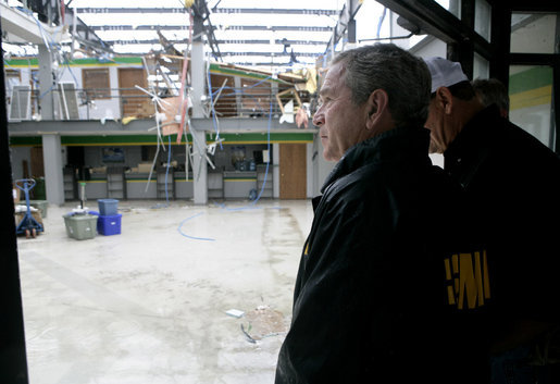 President George W. Bush views the damage done last week's deadly tornado during a stop at the John Deere dealership in Greensburg, Kansas Wednesday, May 9, 2007. At least 11 people died and more than 90 percent of the town was destroyed in the wake of the storm that struck Friday night. White House photo by Eric Draper