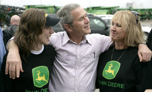 President George W. Bush offers some encouragement to two employees of the John Deere dealership in Greensburg, Kansas Wednesday, May 9, 2007, during a tour of the small, Midwest community that lost nearly 95 percent of its homes and businesses in the wake of a deadly tornado. White House photo by Eric Draper