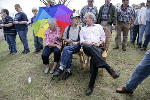 President George W. Bush spends a moment with Cloriene and Kenneth Smith, survivors of Friday's deadly tornado in Greensburg, Kansas, during his visit to the storm-ravaged area Wednesday, May 9, 2007. White House photo by Eric Draper